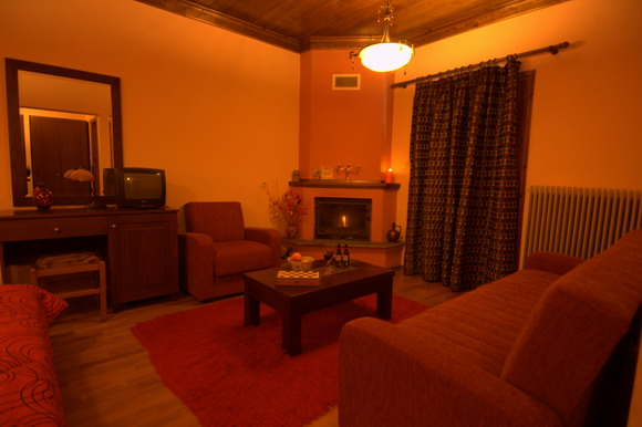 Spacious rooms with a fireplace in Elati
